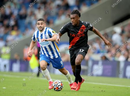 Alex Iwobi of Everton gets away from Neal Maupay of Brighton and Hove Albion