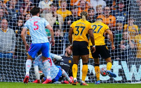 Romain Saiss of Wolves fails to score from close range at 0-0