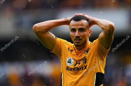 Romain Saiss of Wolves reacts after missing a great chance to score