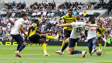 Ismaila Sarr of Watford gets a shot on goal early in the second half but fails to make good contact as Eric Dier of Tottenham Hotspur (15) tries to block
