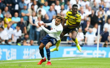 Dele Alli of Tottenham Hotspur fouls Ismaila Sarr of Watford and receives a yellow card