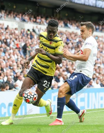 Ismaila Sarr of Watford takes on Sergio Reguilon of Tottenham Hotspur