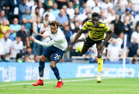 Dele Alli of Tottenham Hotspur fouls Ismaila Sarr of Watford