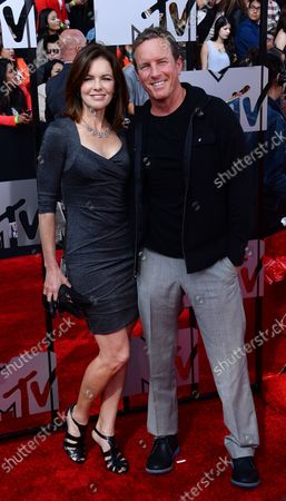 Actors Susan Walters (L) and Linden Ashby arrive for The MTV Movie Awards at Nokia Theatre L.A. Live in Los Angeles, California on April 13, 2014.