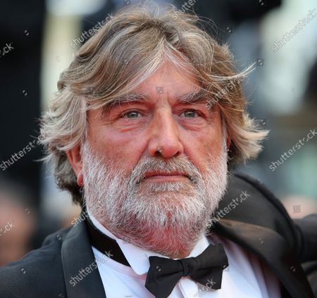 """Stock Image of Pierre Ange Le Pogam arrives on the red carpet before the screening of the film """"Grace of Monaco"""" during the 67th annual Cannes International Film Festival in Cannes, France on May 14, 2014."""