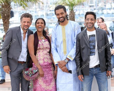 """(From L to R) Abel Jafri, Toulou Kiki, Ibrahim """"Pino"""" Ahmed  and Hichem Yacoubi arrive at a photo call for the film """"Timbuktu"""" during the 67th annual Cannes International Film Festival in Cannes, France on May 15, 2014."""