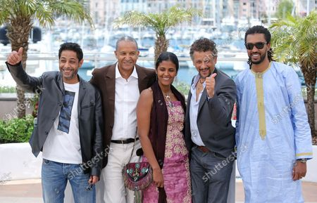 """Stock Image of (From L to R) Hichem Yacoubi, Abderrahmane Sissako, Toulou Kiki, Abel Jafri and Ibrahim """"Pino"""" Ahmed arrive at a photo call for the film """"Timbuktu"""" during the 67th annual Cannes International Film Festival in Cannes, France on May 15, 2014."""