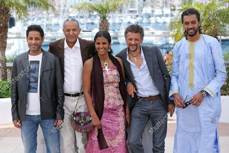 """(From L to R) Hichem Yacoubi, Abderrahmane Sissako, Toulou Kiki, Abel Jafri and Ibrahim """"Pino"""" Ahmed arrive at a photo call for the film """"Timbuktu"""" during the 67th annual Cannes International Film Festival in Cannes, France on May 15, 2014."""