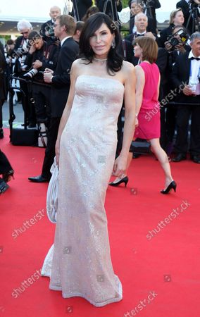 """Mouna Ayoub arrives on the red carpet before the screening of the film """"Mr. Turner"""" during the 67th annual Cannes International Film Festival in Cannes, France on May 15, 2014."""