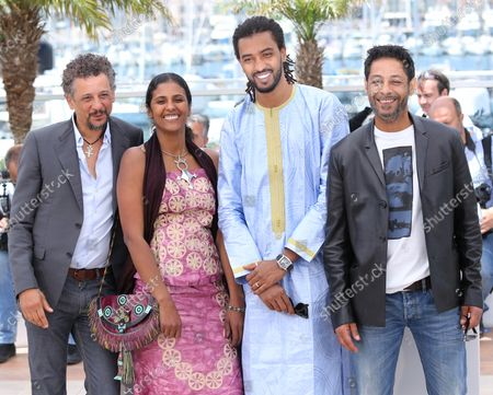 """Stock Picture of (From L to R) Abel Jafri, Toulou Kiki, Ibrahim """"Pino"""" Ahmed  and Hichem Yacoubi arrive at a photo call for the film """"Timbuktu"""" during the 67th annual Cannes International Film Festival in Cannes, France on May 15, 2014."""