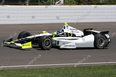 Josef Newgarden speeds through the north short chute during race day set up tests for the 98th running of the Indianapolis 500 at the Indianapolis Motor Speedway on May 19, 2014 in Indianapolis, Indiana. Newgarden had the fastest speed at 227.105 MPH for the Sarah Fisher racing team.