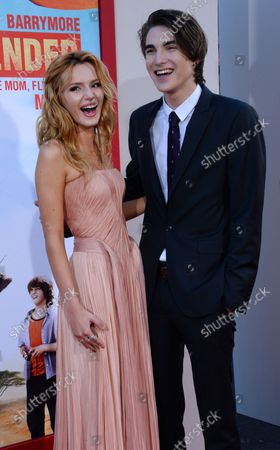 """Cast members Bella Thorne (L) and Zak Henri attend the premiere of the motion picture comedy """"Blended"""" at TCL Chinese Theatre (formerly Grauman's) in the Hollywood section of Los Angeles on May 21, 2014. Storyline: After a blind date gone horribly wrong, Jim and Lauren agree they never, ever want to see each other again. Well, that's all about to change when the two find themselves and their respective families (including children) all stuck together in one suite at an African Safari vacation spot."""