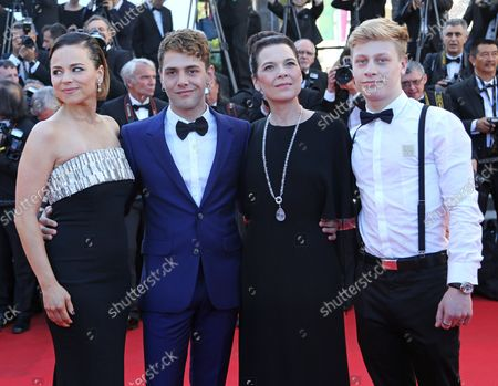 """(From L to R) Suzanne Clement, Xavier Dolan, Anne Dorval and Antoine-Olivier Pilon arrive on the closing ceremony red carpet before the screening of the film """"Fistful of Dollars"""" during the 67th annual Cannes International Film Festival in Cannes, France on May 24, 2014."""