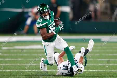 New York Jets' Jeff Smith (16) breaks a tackle by Philadelphia Eagles' Andrew Adams during the second half of an NFL preseason football game, in East Rutherford, N.J