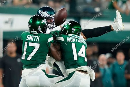 Philadelphia Eagles' Andrew Adams, center, fights for control of the ball with New York Jets' Vyncint Smith (17) and D.J. Montgomery (14) during the second half of an NFL preseason football game, in East Rutherford, N.J