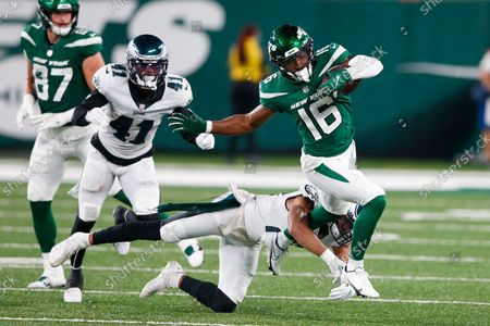 New York Jets' Jeff Smith (16) breaks a tackle by Philadelphia Eagles' Andrew Adams as Kevon Seymour (41) chases him during the second half of an NFL preseason football game, in East Rutherford, N.J