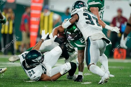 Philadelphia Eagles' Grayland Arnold (37) and Andrew Adams (21) tackle New York Jets' Ashtyn Davis (21) during the second half of an NFL preseason football game, in East Rutherford, N.J
