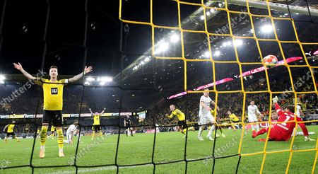 Dortmund's Erling Haaland (C) celebrates with Dortmund's Marco Reus (L) after scoring the 3-2 lead during the German Bundesliga soccer match between Borussia Dortmund and TSG Hoffenheim in Dortmund, Germany, 27 August 2021.