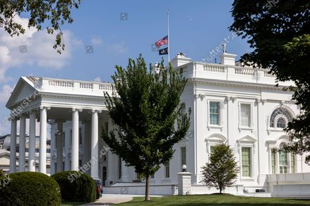 The US flag flies at half-staff above the White House in Washington, DC, USA, 27. A suicide bomber from ISIS-K killed more than 100 people, including 13 US troops, outside Hamid Karzai International Airport in Kabul, Afghanistan on 26 August.