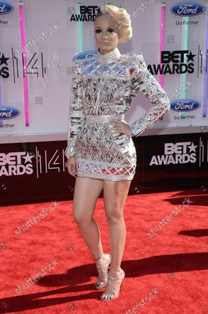 Musician Charli Baltimore attends the 14th annual BET Awards at Nokia Theatre L.A. Live in Los Angeles on June 29, 2014. The award show spotlights the 50th anniversary of the Civil Rights Bill and its impact on America.