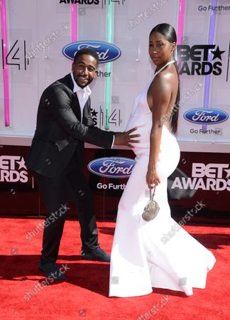 Musician Omarion, left, and Apryl Jones  attends the 14th annual BET Awards at Nokia Theatre L.A. Live in Los Angeles on June 29, 2014. The award show spotlights the 50th anniversary of the Civil Rights Bill and its impact on America.