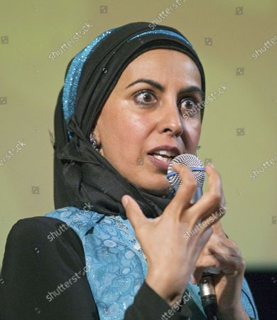 """British-Canadian author and filmmaker Zarqa Nawaz gives a talk and Q & A hosted by actress Anita Majumdar at Simon Fraser University's Goldcorp Centre for the Performing Arts introducing her new book """"Laughing All the Way to the Mosque"""" in Vancouver, British Columbia, June 9, 2014. Best known for creating the hit television series """"Little Mosque on the Prairie"""" Nawaz hopes to put the fun back into fundamentalism which is the theme of her talk at the Indian Summer Festival."""