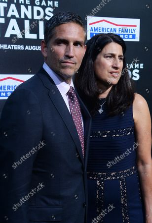 """Stock Image of Cast member Jim Caviezel and his wife Kerri Browitt Caviezel attend the premiere of the motion picture sports drama """"When the Game Stands Tall"""" at the ArcLight Cinerama Dome in the Hollywood section of Los Angeles on August 4, 2014. Inspired by a true story, the film tells the remarkable journey of legendary football coach Bob Ladouceur (Jim Caviezel), who took the De La Salle High School Spartans from obscurity to a 151-game winning streak that shattered all records for any American sport."""