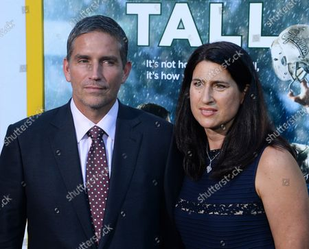 """Stock Photo of Cast member Jim Caviezel and his wife Kerri Browitt Caviezel attend the premiere of the motion picture sports drama """"When the Game Stands Tall"""" at the ArcLight Cinerama Dome in the Hollywood section of Los Angeles on August 4, 2014. Inspired by a true story, the film tells the remarkable journey of legendary football coach Bob Ladouceur (Jim Caviezel), who took the De La Salle High School Spartans from obscurity to a 151-game winning streak that shattered all records for any American sport."""