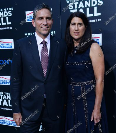 """Stock Picture of Cast member Jim Caviezel and his wife Kerri Browitt Caviezel attend the premiere of the motion picture sports drama """"When the Game Stands Tall"""" at the ArcLight Cinerama Dome in the Hollywood section of Los Angeles on August 4, 2014. Inspired by a true story, the film tells the remarkable journey of legendary football coach Bob Ladouceur (Jim Caviezel), who took the De La Salle High School Spartans from obscurity to a 151-game winning streak that shattered all records for any American sport."""