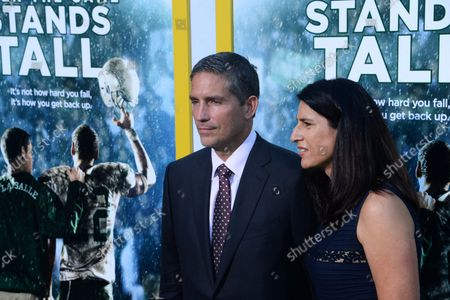 """Cast member Jim Caviezel and his wife Kerri Browitt Caviezel attend the premiere of the motion picture sports drama """"When the Game Stands Tall"""" at the ArcLight Cinerama Dome in the Hollywood section of Los Angeles on August 4, 2014. Inspired by a true story, the film tells the remarkable journey of legendary football coach Bob Ladouceur (Jim Caviezel), who took the De La Salle High School Spartans from obscurity to a 151-game winning streak that shattered all records for any American sport."""