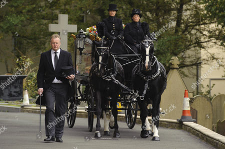 The hearse travels through the streets of Douglas