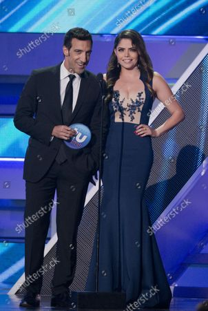Presenters Alberto Mateo and Yarel Ramos read a list of finalists  at the 2014 Premios Tu Mundo  show and awards at the American Airlines Arena in Miami,Florida on August 21, 2014.