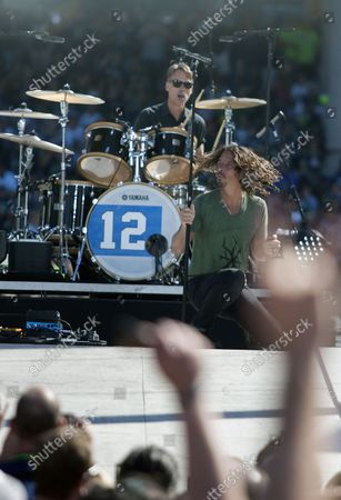 Seattle-natives and Grammy Award-winning band Soundgarden's' singer and rhythm guitarist Chris Cornell and drummer Matt Cameron performs during the  2014 NFL Kickoff presented by XBOX held at CenturyLink Field on September 4, 2014 in Seattle.