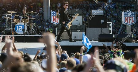 Seattle-natives and Grammy Award-winning band Soundgarden's lead guitarist Kim Thayil , right, and drummer Matt Cameron performs during the  2014 NFL Kickoff presented by XBOX held at CenturyLink Field on September 4, 2014 in Seattle.