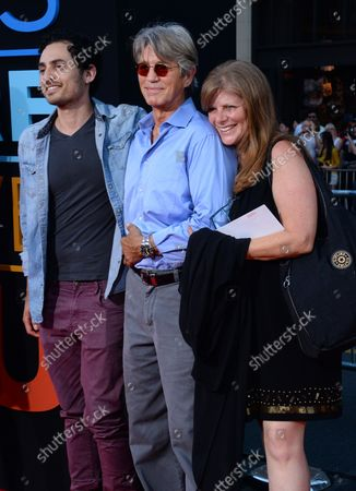 """Actor Eric Roberts (C) attends the premiere of the motion picture comedy """"This Is Where I Leave You"""" with his wife Eliza Roberts and recording artist Keaton Simons at TCL Chinese Theatre in the Hollywood section of Los Angeles on September 15, 2014. Storyline: When their father passes away, four grown siblings are forced to return to their childhood home and live under the same roof together for a week, along with their over-sharing mother and an assortment of spouses, exes and might-have-beens."""