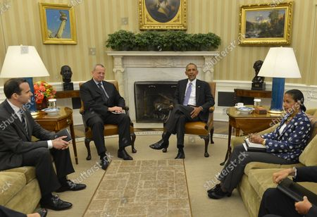 U.S. President Barack Obama (2nd,R) meets with Special Presidential Envoy for the Global Coalition to Counter ISIS Gen. John Allen (2nd,L),  Deputy Special Presidential Envoy Brett McGurk (L) and National Security Advisor Susan E. Rice for talks in the Oval Office on combating the Islamic State of Iraq and Syria (ISIS), September 16, 2014, in Washington, DC. Obama plans on a coalition of forces to rollback ISIS advances in Syria and Iraq.