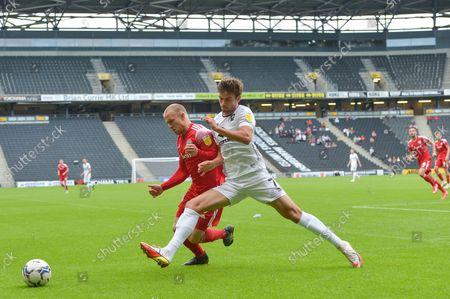 Accrington Stanley midfielder David Morgan  (37) and MK Dons midfielder Matt O'Riley  (7) battle for possession during the EFL Sky Bet League 1 match between Milton Keynes Dons and Accrington Stanley at stadium:mk, Milton Keynes