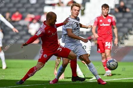 MK Dons forward Scott Twine  (9) and Accrington Stanley midfielder David Morgan  (37) battle for possession in the goal area during the EFL Sky Bet League 1 match between Milton Keynes Dons and Accrington Stanley at stadium:mk, Milton Keynes