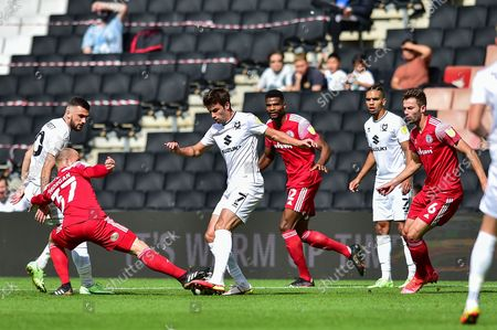 Accrington Stanley midfielder David Morgan  (37) and MK Dons midfielder Matt O'Riley  (7) battle for possession of the ball during the EFL Sky Bet League 1 match between Milton Keynes Dons and Accrington Stanley at stadium:mk, Milton Keynes