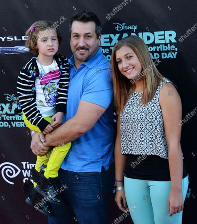 """Actor Joey Fatone and his daughters Kloey Alexander Fatone (L) and Briahna Fatone attend the premiere of the motion picture family comedy """"Alexander and the Terrible, Horrible, No Good, Very Bad Day"""" at the El Capitan Theatre in the Hollywood section of Los Angeles on October 6, 2014. Storyline: Alexander's day begins with gum stuck in his hair, followed by more calamities. Though he finds little sympathy from his family and begins to wonder if bad things only happen to him, his mom, dad, brother, and sister all find themselves living through their own terrible, horrible, no good, very bad day."""