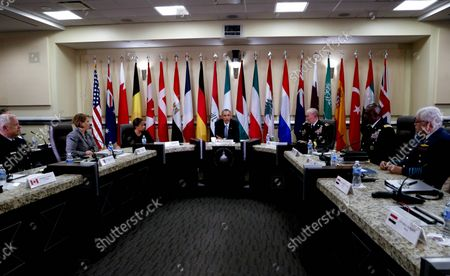 U.S. President Barack Obama (C), Joint Chiefs of Staff General Martin E. Dempsey (R), National Security Advisor Susan Rice (L),  Homeland Security Advisor Lisa Monaco (2L) and Central Command General Lloyd Austin III (2R) meet 20 foreign Chiefs of Defense to discuss a coalition efforts in the ongoing campaign against ISIL (ISIS) on October 14, 2014 at Andrew Air Force Base in Maryland. Representatives from Australia, Bahrain, Belgium, Canada, Denmark, Egypt, France, Germany, Iraq, Italy, Jordan, Kuwait, Lebanon, the Netherlands, New Zealand, Qatar, Saudi Arabia, Spain, Turkey and the United Arab Emirates attended.