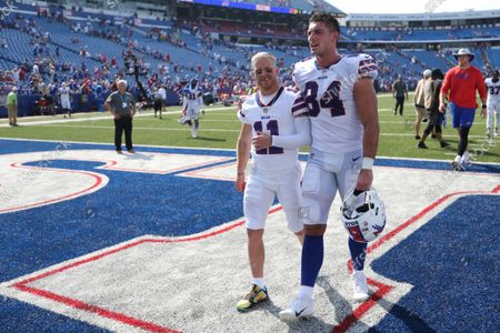 Buffalo Bills wide receiver Cole Beasley (11) and tight end Nate Becker (84) head to the locker room after a preseason NFL football game, in Orchard Park, N.Y