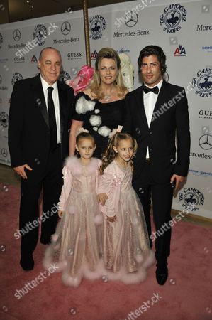 Stock Picture of Ken Rickel, wife Nancy Davis and daughters with Brandon Davis