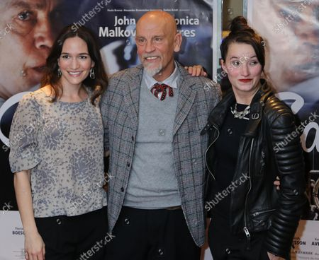 """Kate Lindsey (L), John Malkovich (C) and Anna Prohaska arrive at the French premiere of the film """"The Casanova Variations"""" in Paris on November 3, 2014."""