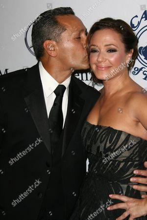 Stock Photo of Leah Remini and husband Angelo Pagan