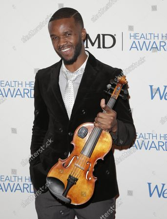 Lee England Jr. arrives on the red carpet at the 2014 Health Hero Awards hosted by WebMD at Times Center in New York City on November 6, 2014.