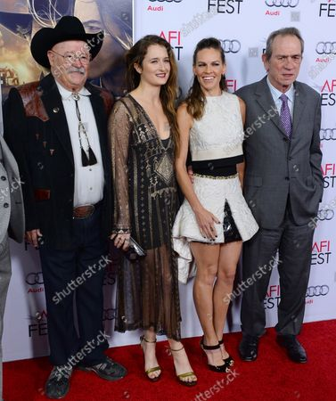 """Cast members Barry Corbin, Grace Gummer, Hilary Swank and Tommy Lee Jones (L-R) pose during the premiere of the motion picture western drama """"The Homesman"""" as part of AFI Fest at the Dolby Theatre in the Hollywood section of Los Angeles on November 11, 2014. Storyline: Three women who have been driven mad by pioneer life are to be transported across the country by covered wagon by the pious, independent-minded Mary Bee Cuddy (Swank), who in turn employs low-life drifter George Briggs (Jones) to assist her."""