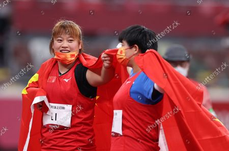 (210828) - TOKYO, Aug 28, 2021 (Xinhua) - Li Yingli (L) and Mi Na of China celebrate after the women's F37 class shot put final of athletics event at the Tokyo 2020 Paralympic Games in Tokyo, Japan, Aug 28, 2021.