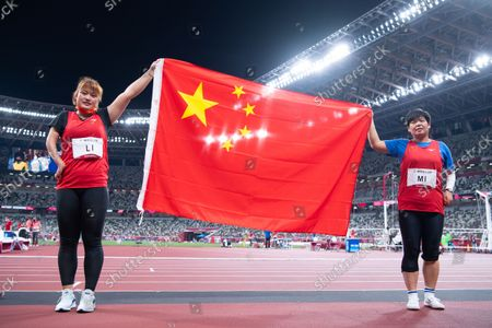 Stock Photo of (210828) - TOKYO, Aug 28, 2021 (Xinhua) - Li Yingli (L) and Mi Na of China celebrate after the women's F37 class shot put final of athletics event at the Tokyo 2020 Paralympic Games in Tokyo, Japan, Aug 28, 2021.