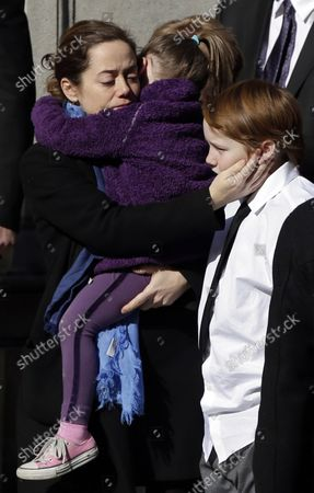 Mimi O'Donnell and children of actor Philip Seymour Hoffman wait out side for the casket to be carried into the funeral of Philip Seymour Hoffman at St. Ignatius Church on Manhattan's Upper East Side in New York City on February 7, 2014. Hoffman, 46, was found dead Sunday of an apparent heroin overdose in his apartment. He leaves behind his partner of 15 years, Mimi O'Donnell, and their three children.